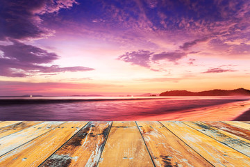 Wood floor top on sunset sky background, Cloudy in orange sky an