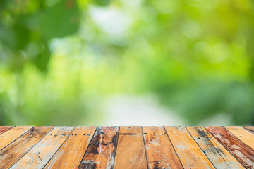 Wooden floor with blurry green nature in background,  Zone of le