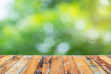 Wooden floor with blurry green nature in background, Zones of le