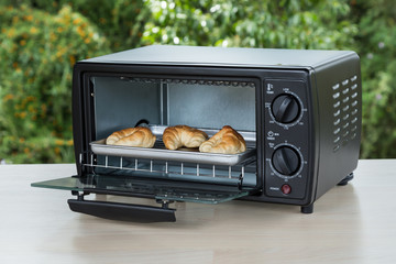 black toaster oven on natural background
