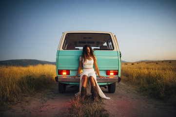 Serious young woman hippie van in car