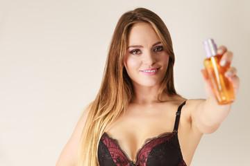 Woman showing moisturizing body oil lotion