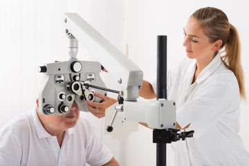 An Optometrist Doing Sight Testing For Patient