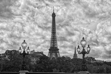Eiffel Tower since Alexandre III Bridge in Paris, France. Black and white.