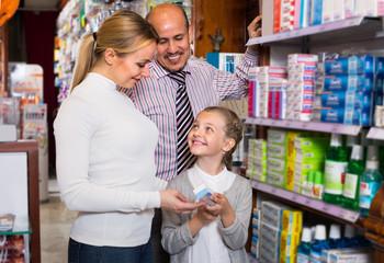 family choosing items in pharmacy