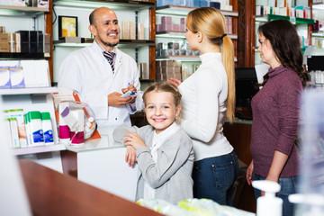Smiling girl in a pharmacy