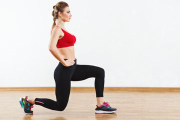 Fit girl doing physical exercises