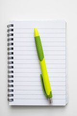 Open blank notebook with a  pencil