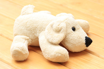 Doll Dog brown on a wooden background