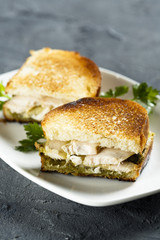 Toasts with chicken and pesto