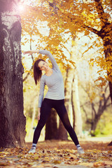 Pretty young girl exercise in the park