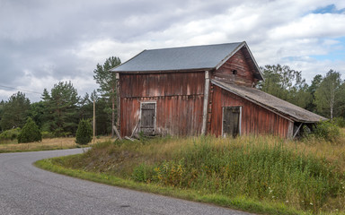 Red barn next to village road