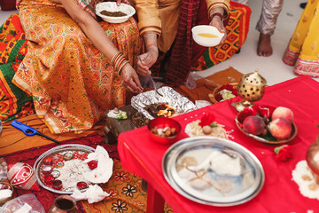 Species and fruits surround Indian parents preparing paste for n