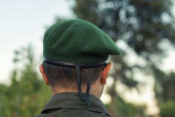 European officer in a green beret