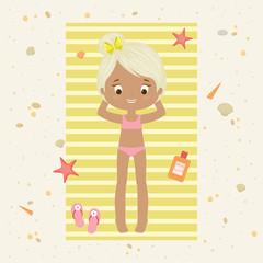 Little girl on a beach towel