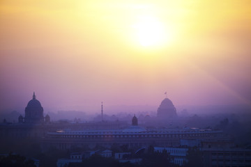 Fotobehang Delhi India. A silhouette of temples and buildings of Delhi in a sunset haze