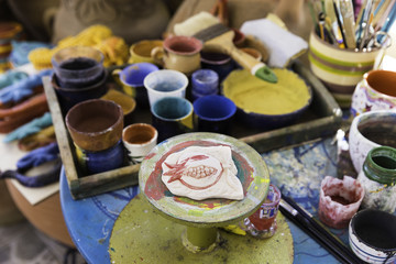 Pomegranate ceramic giftware workshop on a colorful ceramics