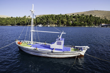 Traditional small fishing boat at sea in Lagkada village, Chios