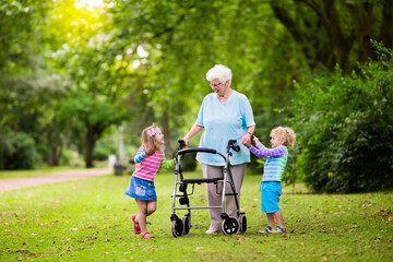 Grandmother with walker playing with two kids
