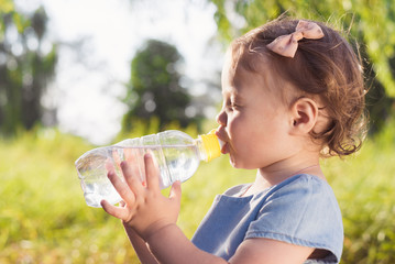 baby drinks water from a bottle