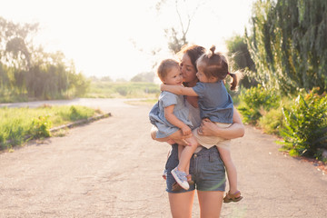 Mother holding two girls on hands