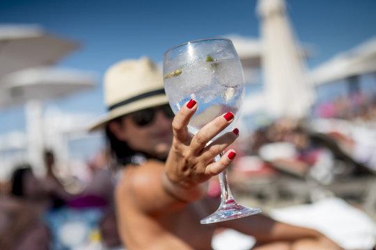 Gin Tonic Girl drinking on the beach