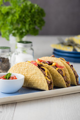 Mexican tacos with beef, cheddar cheese, tomato