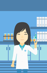 Laboratory assistant with syringe in lab.