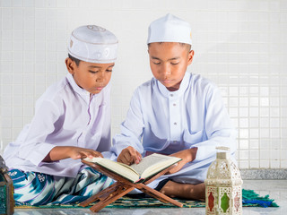 Asian muslim children with smile face read the holy Quran