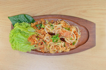 spicy minced pork salad, minced pork mash with spicy, Thai food on the wood background.