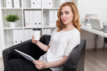 Businesswoman in comfortable armchair