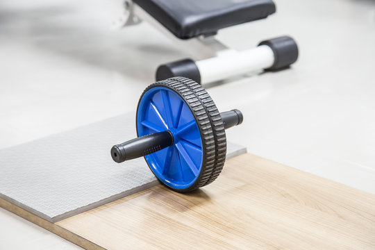 abs training roller,ab wheel in fitness gym.