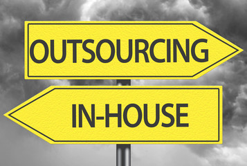 Outsourcing x In-House yellow sign
