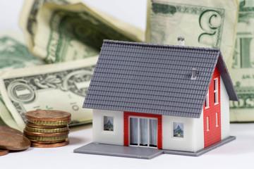 Modellhaus und Geld