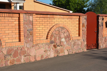 Stone, Brick and Metal Fence with Door of Modern Style Design