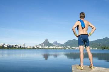 Athlete standing in front of the Rio de Janeiro skyline at Lagoa Rodrigo de Freitas lagoon