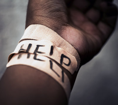 Self-harm wrist cutting concept