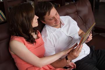 man and woman looking at the photos