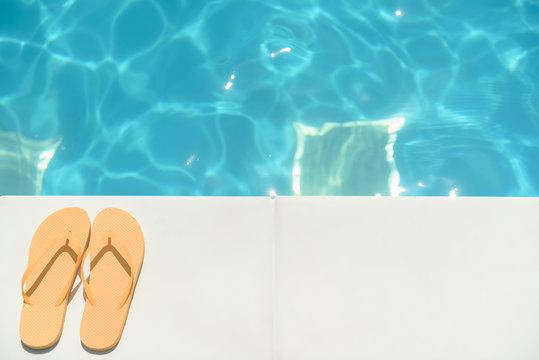 Flip flop shoes near blue water