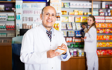 Two pharmacists in chemist shop