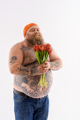 Thick bearded guy with flowers