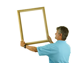 A man is hanging or holding a blank picture frame on wall with white area in frame for your message of image isolated on a white background.