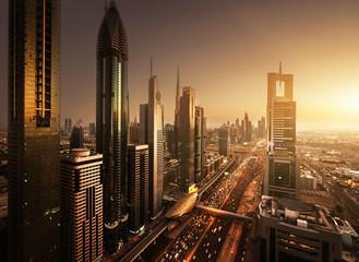 Fotomurales - Dubai skyline in sunset time, United Arab Emirates