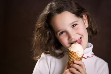 Girl holding and licking ice cream cone
