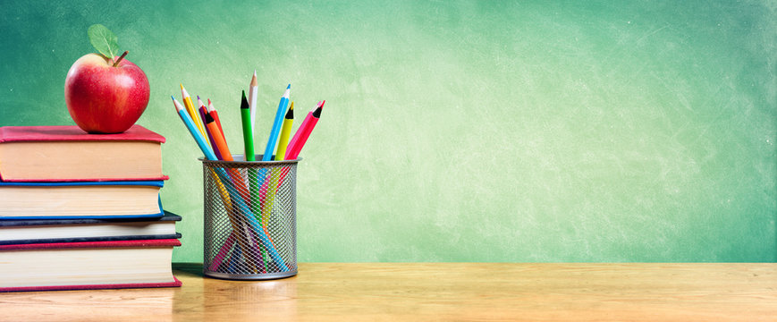 Apple On Stack Of Books With Pencils And Blank Chalkboard - Back To School