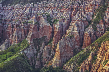 Picturesque landscape at the Red Ravine, a rare natural monument with majestic reddish eroded rough cliffs, naturally carved in shapes of columns, towers and pyramids near Sebes, Alba county, Romania.