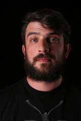 Portrait of bearded guy with interesting look. Close.up. Black
