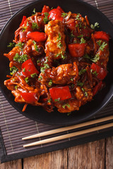 pork with vegetables in a spicy sauce Asian style. Vertical top view