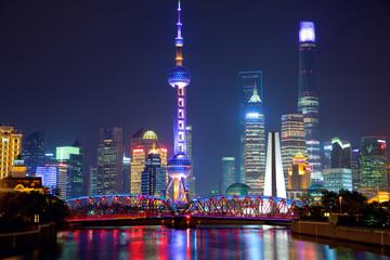Shanghai skyline at night with illuminated Waibaidu bridge, China