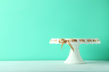 Cake stand on a green wooden table